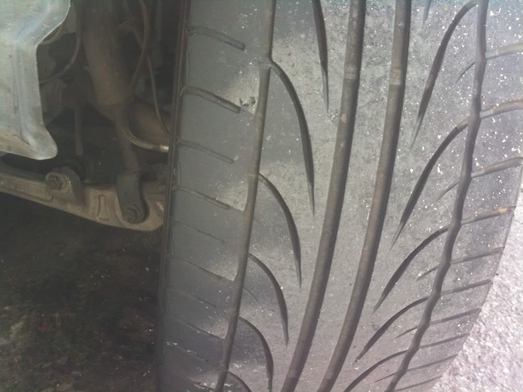 An example of feathering. The lighter areas of the tire are where the rubber is thinner and fatigued because the resistance from the road is being concentrated on just these patches.